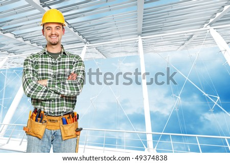 positive handyman with white building interior  portrait - stock photo