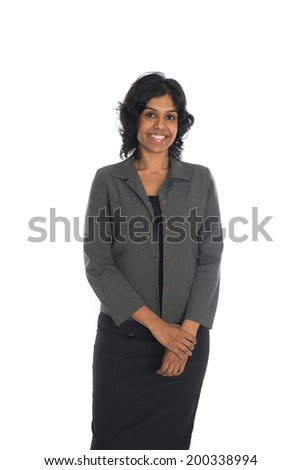 Positive indian business woman smiling over white background