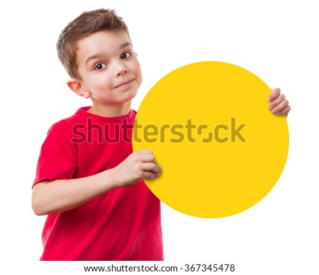Positive little boy holding empty yellow round a sign, isolated on white background - stock photo
