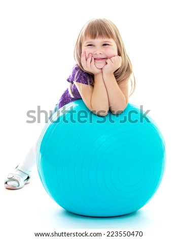 Positive little girl with the blue ball. Happy childhood, fashion, autumnal mood concept. Isolated on white background - stock photo