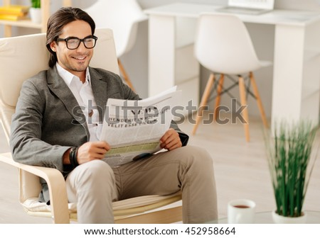 Positive man sitting in the chair