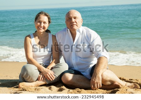 positive mature couple at sea vacation - stock photo