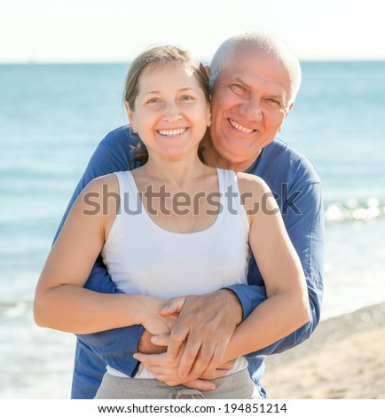 positive mature couple at the vacation - stock photo
