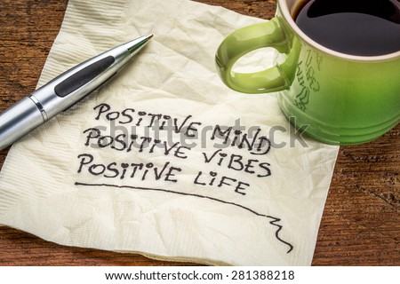 positive mind,  positive vibes, positive life - motivational handwriting on a napkin with a cup of coffee - stock photo