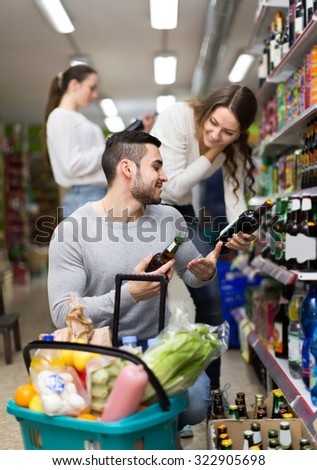 Positive people buying beverages for dinner indoors
