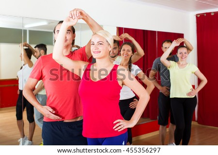 positive people dancing Latino dance in class