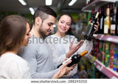Positive   people 30 years old buying beverages for dinner at food shop - stock photo