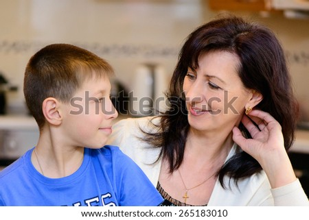 positive portrait of a beautiful family mom and son - stock photo