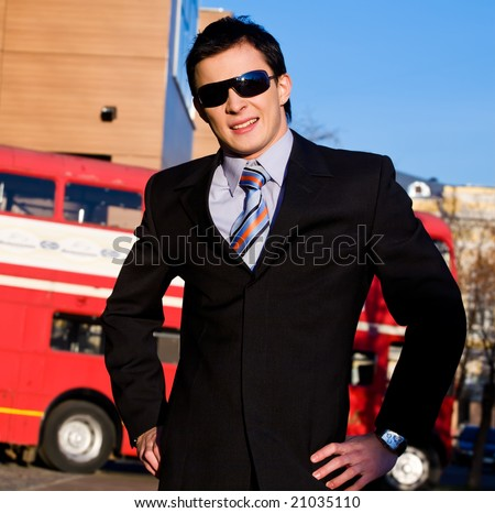 Positive portrait of young businessman outdoors