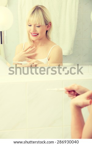 Positive result of pregnancy test. - stock photo