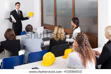 positive russian architects having advanced training courses in classroom - stock photo