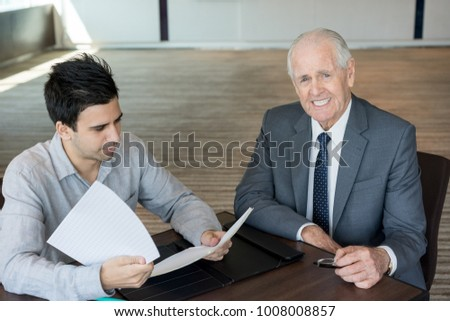 Positive senior businessman at meeting with lawyer