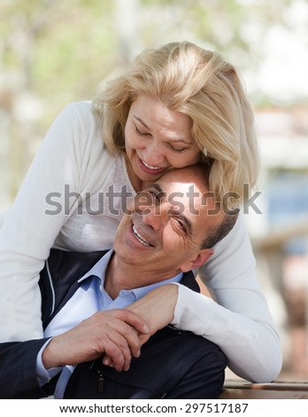 Positive senior mature couple in love outdoor in autumn day