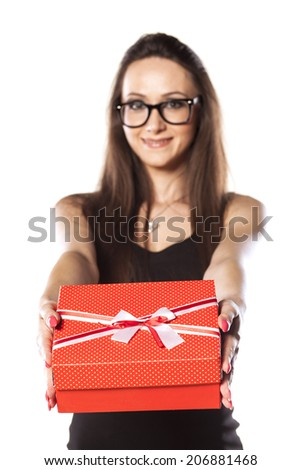positive smiling girl giving a gift box - stock photo