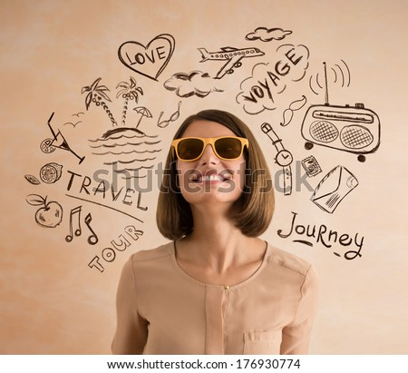 Positive smiling woman wearing sunglasses planning her vacation. Sketches of her plans of trip around her - stock photo