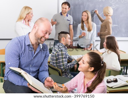 positive students chatting at training session for employees during break in classroom  - stock photo