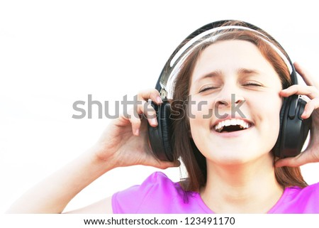 Positive style woman with headphones listening to music or good information