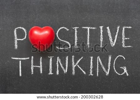 positive thinking phrase handwritten on chalkboard with heart symbol instead of O