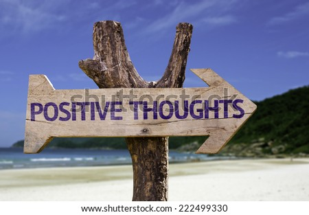 Positive Thoughts wooden sign with a beach on background - stock photo