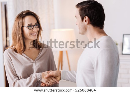 Positive woamn and man shaking hands