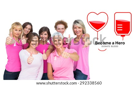 Positive women posing and wearing pink for breast cancer against blood donation - stock photo