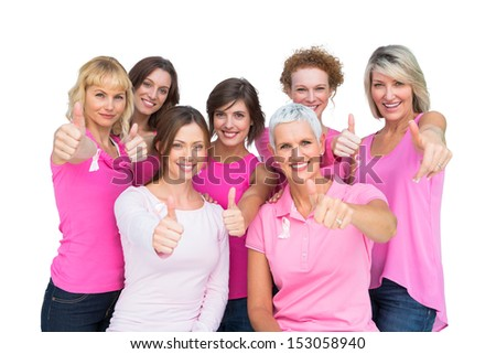 Positive women posing and wearing pink for breast cancer on white background - stock photo