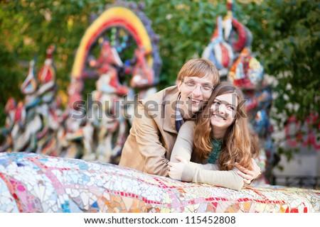 Positive young couple having fun outdoors - stock photo