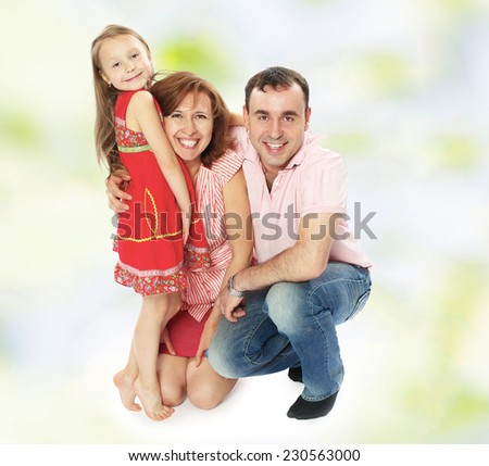 Positive young family dad mom and daughter. - stock photo