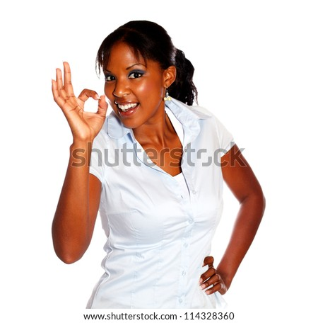 Positive young woman saying great job looking at you on isolated background - stock photo
