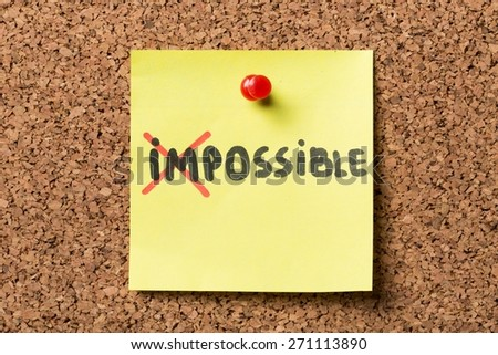 Positivity. The word Impossible turning into Possible on yellow sticky note. - stock photo