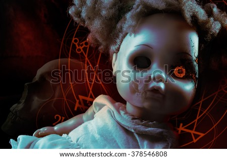 Possessed demonic doll. Possessed demonic horror doll with red pentacles, glowing eye & human skull on background. - stock photo