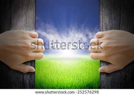 Possible word. Hand opening an old wooden door and found a texts floating over green field and bright blue Sky Sunrise. - stock photo