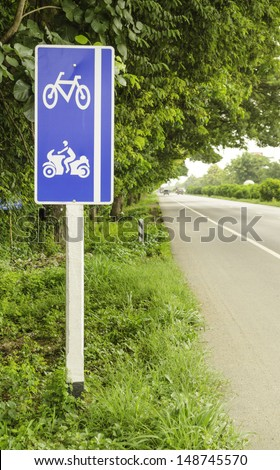 Post a sign on the road bike and a motorcycle in Thailand.