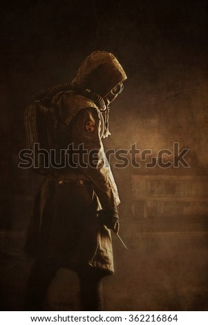 Post apocalypse. Sole survivor in tatters and gas mask on the ruins of the destroyed city  - stock photo
