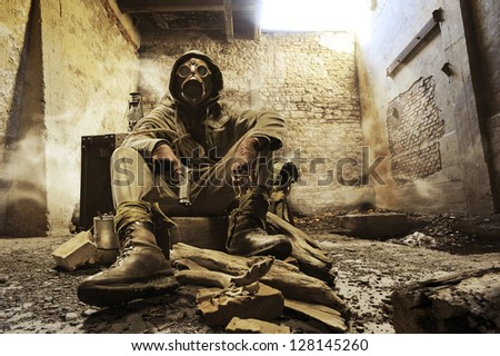 Post apocalyptic survivor in gas mask - stock photo