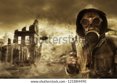 Post apocalyptic survivor in gas mask, destroyed city in the background - stock photo