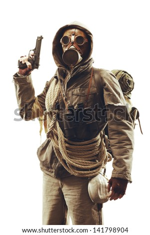 Post apocalyptic survivor in gas mask on white background  - stock photo