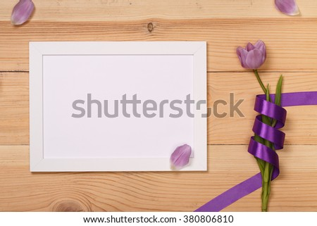 Post blog social media 8 march. View from above with copy space. Banner template layout mockup for woman day. Wooden table, top view on workplace. Lilac tulips at the Desk. - stock photo