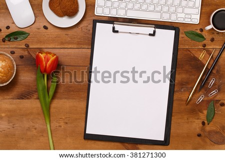 Post blog social media 8 march. View from above with copy space. Banner template layout mockup for woman day. Brown wooden table, top view on workplace. Pink tulips over shabby brown wooden table. - stock photo