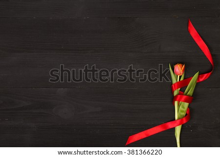 Post blog social media 8 march. View from above with copy space. Banner template layout mockup for woman day. Black wooden table with tulips. festive bouquet for greeting card with place for text - stock photo