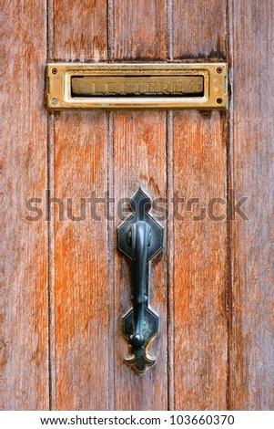 post box on the wooden door - stock photo