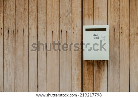 post box on wooden wall - stock photo