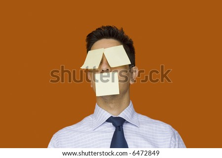 post-it face businessman, he will never forget - stock photo