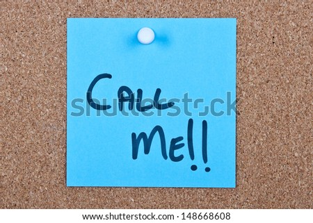 Post it note blue with call me message on cork