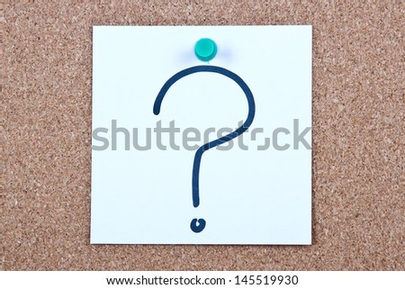 Post it note on wood in white with question mark - stock photo