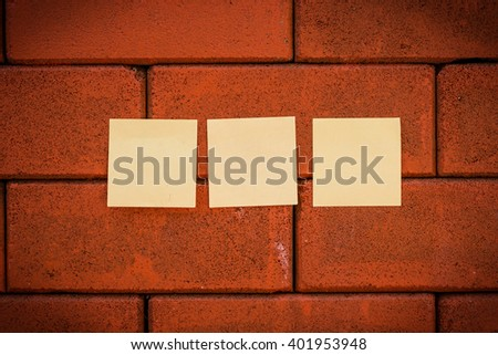Post it note or sticky note on  brick pattern use for background