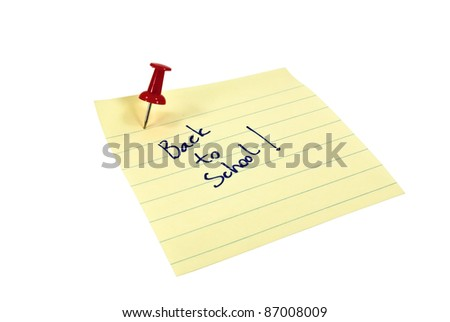 Post it note that reads Back to School and a pin - stock photo
