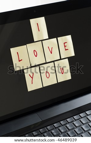 Post it notes spelling I love you on computer screen