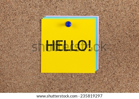 "Post-it notes with word ""Hello!"" on cork board (bulletin board)."
