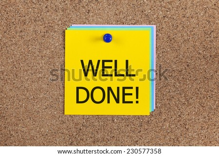 """Post-it notes with word """"Well done!"""" on cork board (bulletin board). - stock photo"""